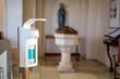Leinwandbild Motiv Disinfection in christian church during the coronavirus pandemic Covid-19