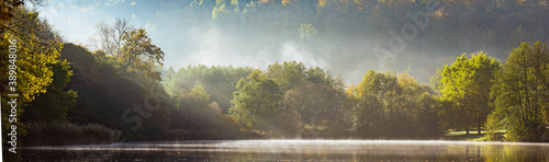Fototapeta Panorama of foggy lake with Autumn foliage and tree reflections in Styria, Thal, Austria obraz