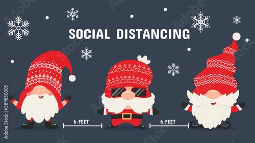 Fototapeta Three lovely Christmas gnomes stand socially spaced. Coronavirus protection ideas at Christmas. obraz
