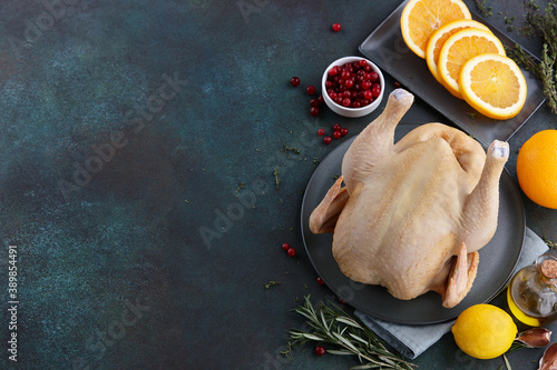 Raw turkey or chicken cooking for Thanksgiving dinner. Holiday preparation.