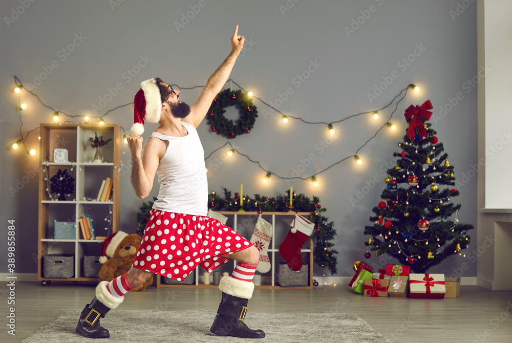 Fototapeta Funny man wants to have fun and announces start of big New Year sales with best deals and bargains