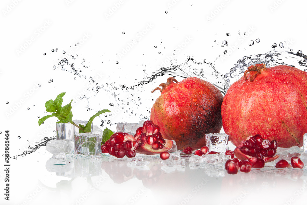 Fototapeta pomegranate with mint and lemon with splashing water and ice..