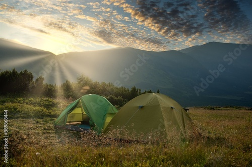 view of tourist tent in mountains at sunrise or sunset Canvas