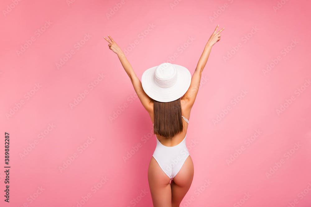 Fototapeta Rear back behind view of her she nice-looking attractive well-groomed sportive slim fit thin straight-haired lady perfect shape form figure having fun showing v-sign isolated on pink pastel background
