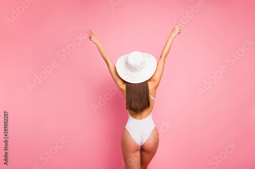 Obraz Rear back behind view of her she nice-looking attractive well-groomed sportive slim fit thin straight-haired lady perfect shape form figure having fun showing v-sign isolated on pink pastel background - fototapety do salonu