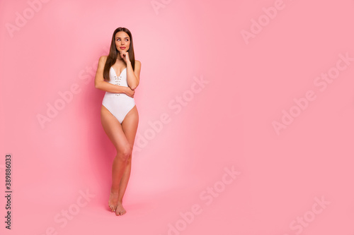 Obraz Full length body size view of her she nice-looking attractive lovely lovable adorable sweet winsome stunning fit thin sportive straight-haired lady posing creating plan isolated over pink background - fototapety do salonu