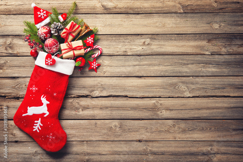 Fotografering christmas stocking with gifts