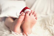 Child Feet With Santa Hat On B...