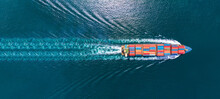 Aerial Top View Of Cargo Ship With Contrail In The Ocean Sea Ship Carrying Container And Running  From Container International Port To Custom Ocean Concept Smart Freight Shipping By Ship Service