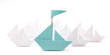 Blue Paper Ship With Small Boa...