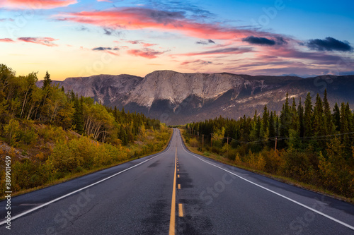 Obraz na plátně View of Scenic Road surrounded by Trees and Rocky Mountains on a Cloudy Fall Season in Canadian Nature