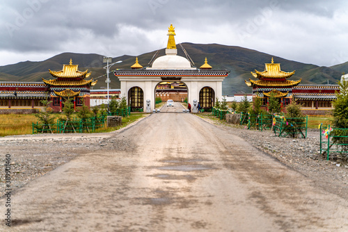 The entrance golden gate to the tibetan buddhist monastery Wallpaper Mural