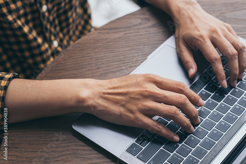 Obraz using computer.woman hand typing keyboard laptop online chatting search form internet working sitting at coffee shop.concept for technology device contact communication business people - fototapety do salonu