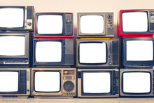 Pile Of Old Retro TVs With Cut Out Screen In Room, Clipping Path, Vintage Filter Effect