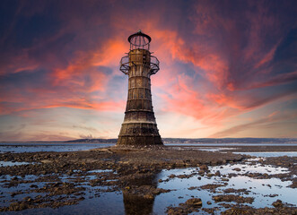 This derelict iron lighthouse is situated on Whiteford Sands, the Gower, Swansea. It is the last iron lighthouse in Europe. Sun setting at the end of a winter day.