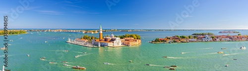 Aerial panoramic view of Venetian Lagoon with San Giorgio Maggiore island, Lido island and Giudecca island, sailing boats in Giudecca Canal, blue sky, Venice city, Italy Fototapet