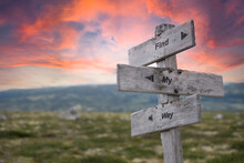 Find My Way Text Engraved In Wooden Signpost Outdoors In Nature During Sunset And Pink Skies.