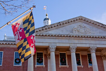 Close Up View Of Maryland State Flag In Front Of The Capitol State House In Annapolis, MD.