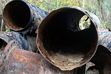 A Lot Of Cut Old Metal Rusted Large Diameter Pipes