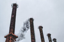Industrial Pipes Of A Chemical Plant. Air Pollution By Toxic Fumes