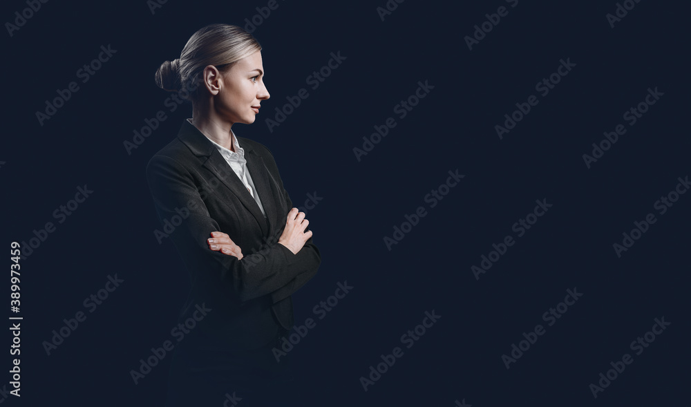 Fototapeta business woman, the concept of a strong and independent business woman. woman in a strict black suit and white buzet on a dark background