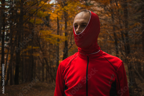 Fotografie, Obraz Person looking stupid in the woods with buf or head band pulled over his head just partially