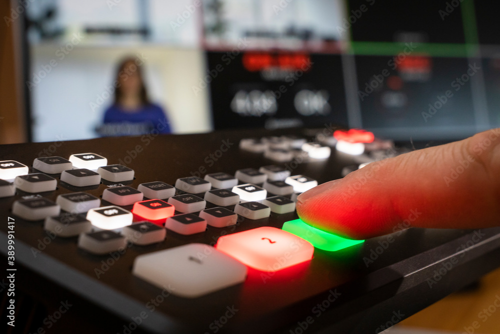 Fototapeta Professional equipment for live video streaming, man pushes button, monitor with split screen