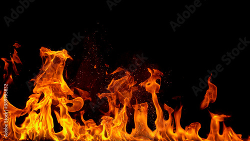 Obraz fire flames with sparks on a black background, close-up - fototapety do salonu