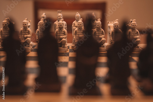 Closeup shot of a chessboard with human pieces Fototapet