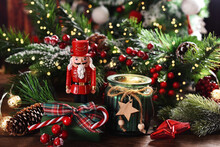 Christmas Decoration With A Candle And A Nutcracker