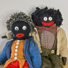 Two Golligwogs Sitting Close Together