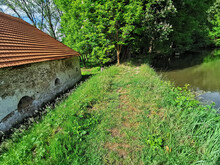 Small Water Pond New To A Rural Building With A Red-tiled Roof