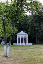 White Gazebo In Roman Style In The Park
