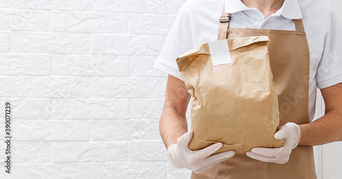 Obraz na plátně Holding take-out food paper bag, coffee cup