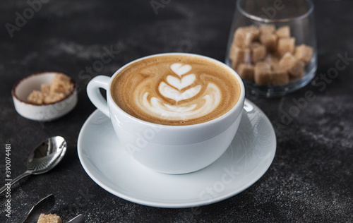 aromatic cappuccino in a white cup on a dark background. Fototapeta