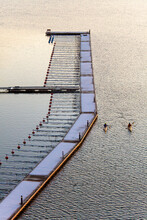 Kayaks Glide Past A Sailboat J...