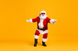 canvas print picture Full size photo of funky santa claus with grey beard listen x-mas christmas music song headset dance wear sunglass headwear cap isolated over bright shine color background