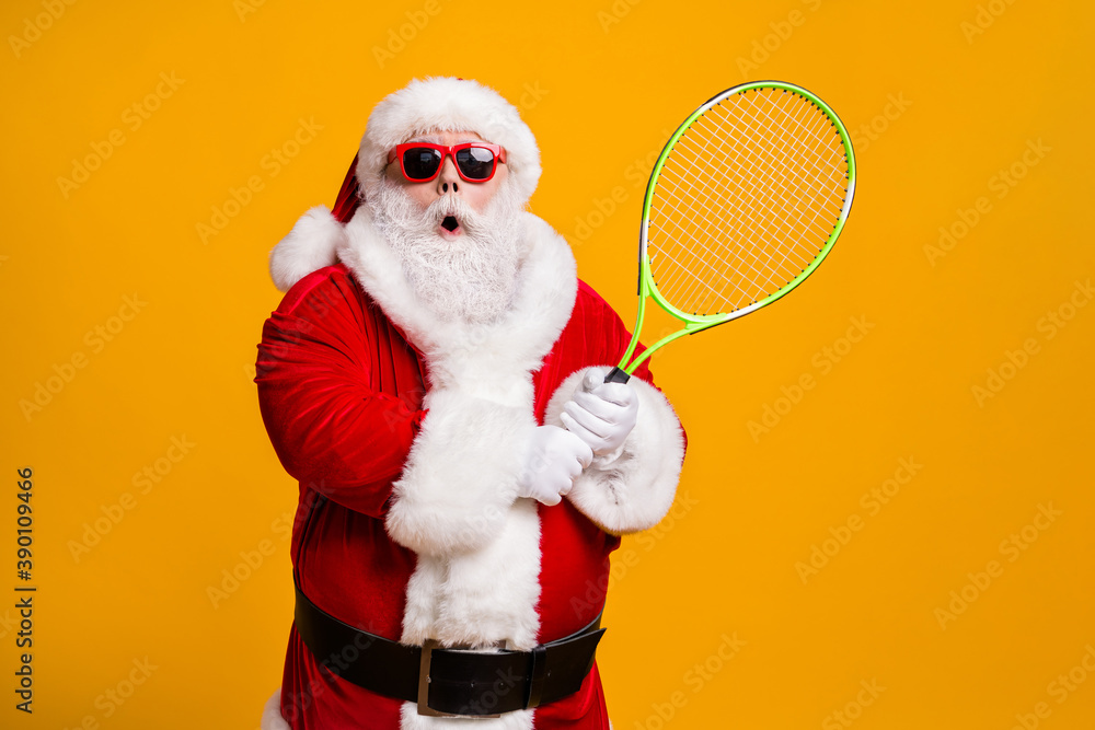 Fototapeta Portrait of his he nice attractive amazed stunned wondered funny Santa enjoying playing badminton team cup contest workout isolated bright vivid shine vibrant yellow color background