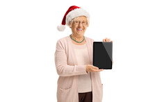 Mature Woman Showing A Digital Tablet And Wearing A Santa Claus Hat