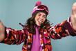Cheerful young woman wearing snowboard gear
