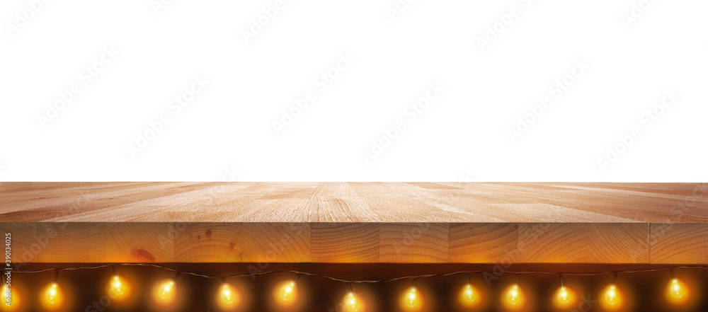 Fototapeta A Christmas beech wood tabletop product display with fairy, Christmas tree lights underneath it isolated on a white background.
