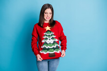 What An Uncomfortable Pullover. Photo Portrait Disgusted Girl Wearing Nasty Jumper Star Googly Eyes Tree Pulling With Hands Isolated On Pastel Light Blue Colored Background