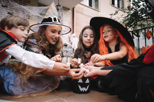 Children Sharing And Comparing Their Candies On Halloween