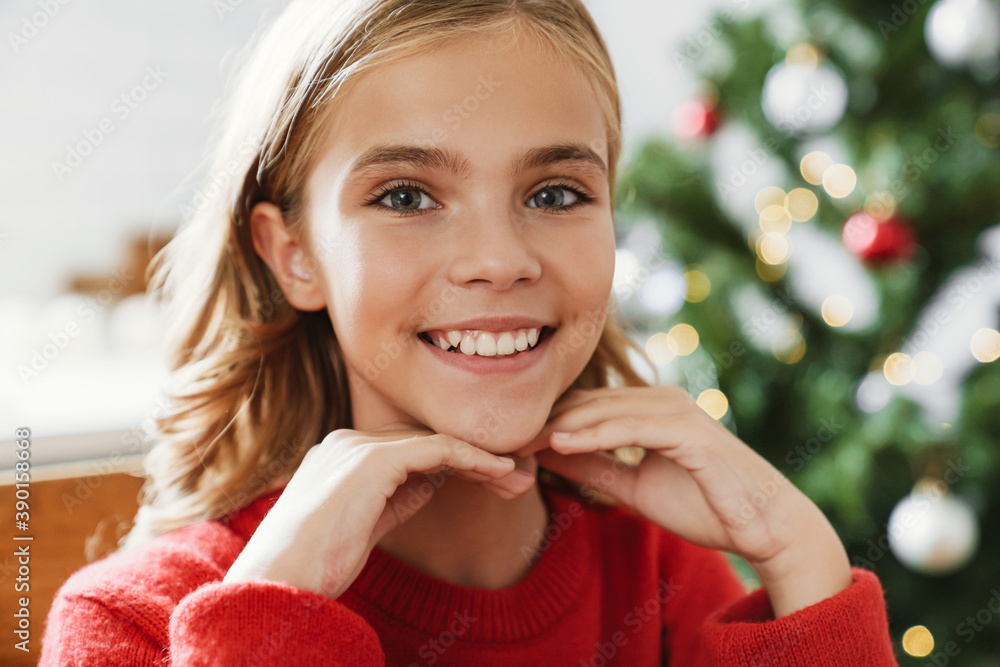 Fototapeta Happy caucasian girl smiling and looking at camera