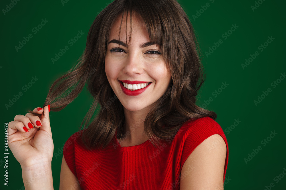 Fototapeta Beautiful happy brunette girl smiling and looking at camera