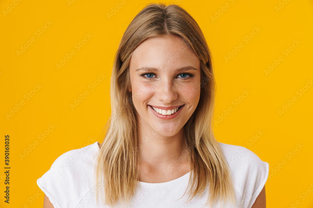 Fototapeta Cheerful beautiful girl smiling and looking at camera
