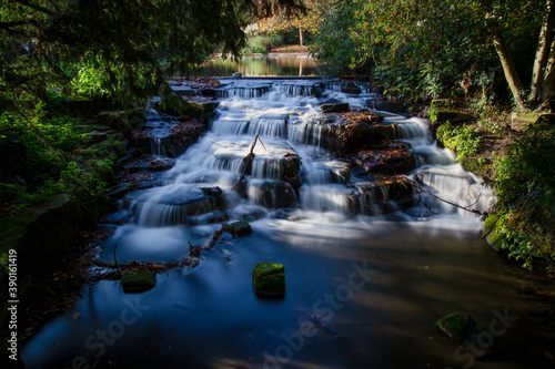 Long exposure of Carshalton Ponds Waterfall in Grove Park, Sutton, London, England