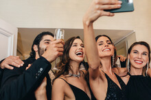 Socialites Taking Selfie At A Party