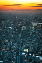Aerial View Of Illuminated Tokyo Tower In City During Sunrise