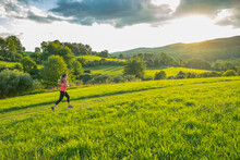 USA, Woman Running In Field